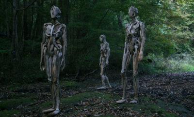 creepy wood statues