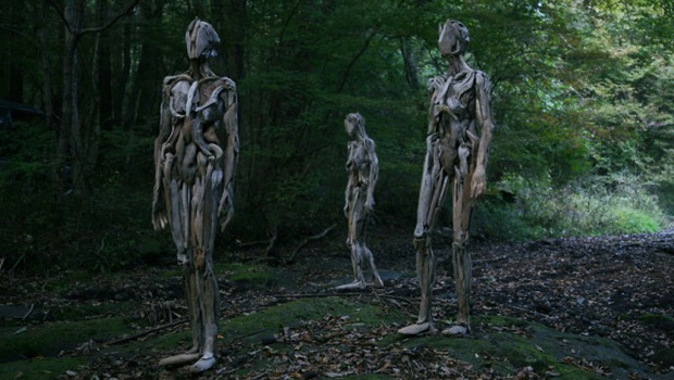 creepy wood statues